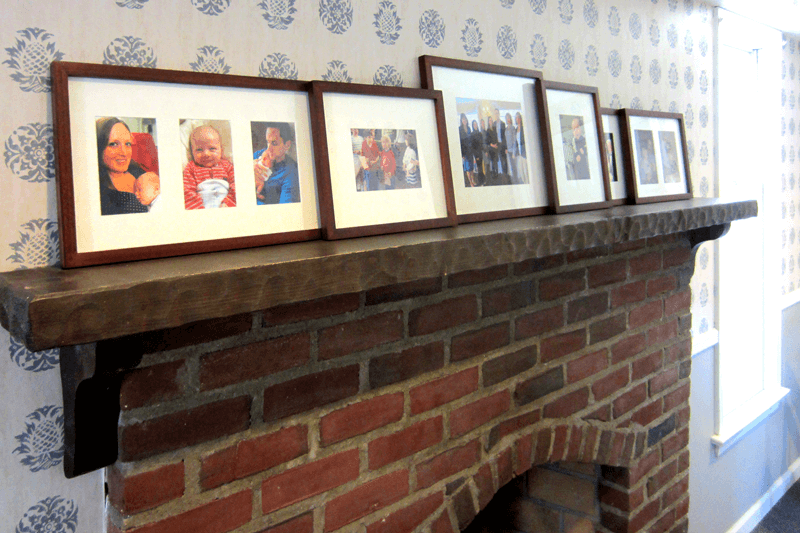 Photos on the fireplace mantle